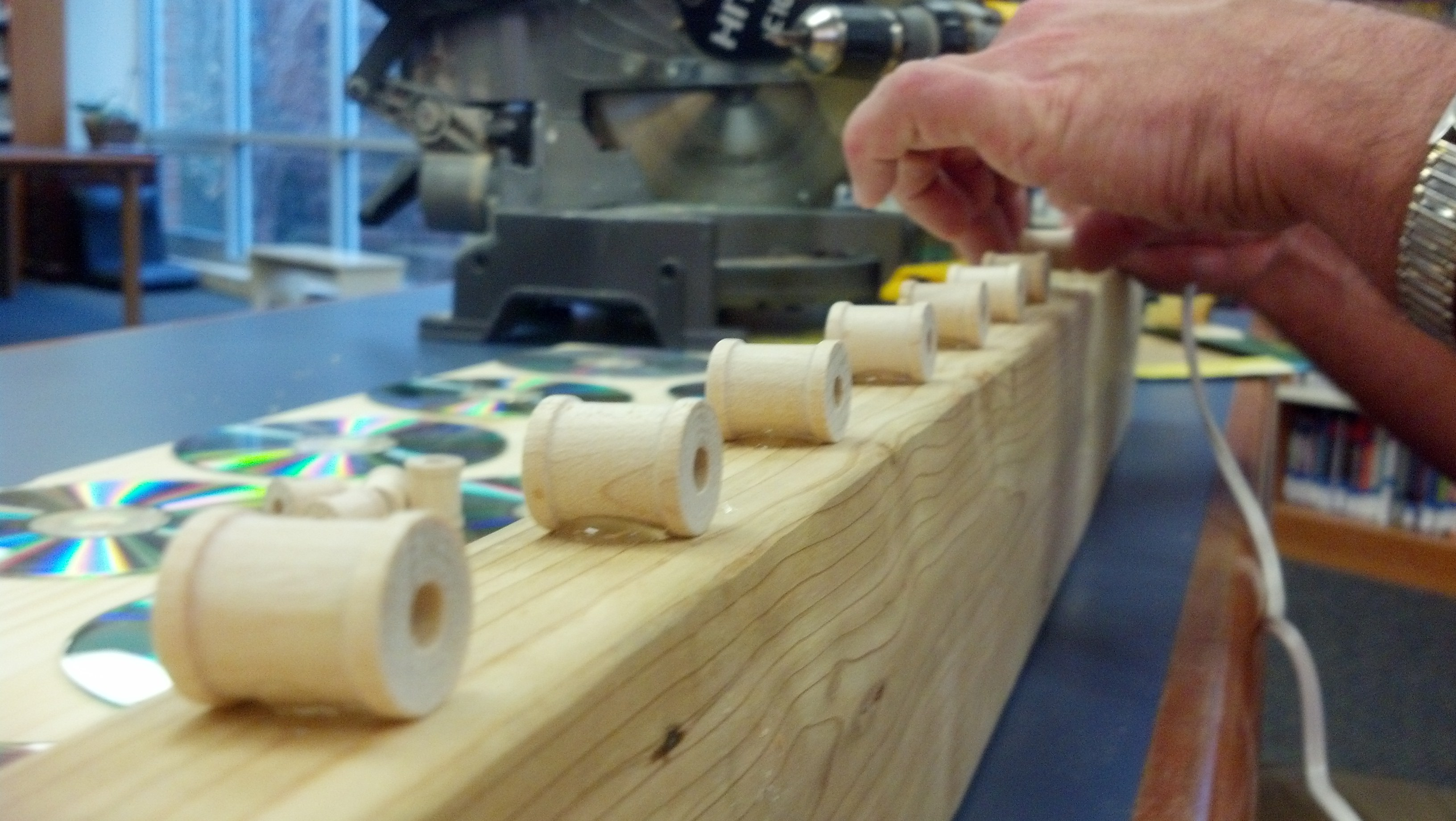 Picture of Glue on the Wooden Spools
