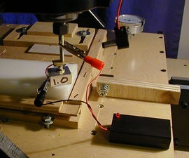 Make a spring loaded 'touch block' for setting the tool height (Z-Axis) on a CNC Mill or Router.