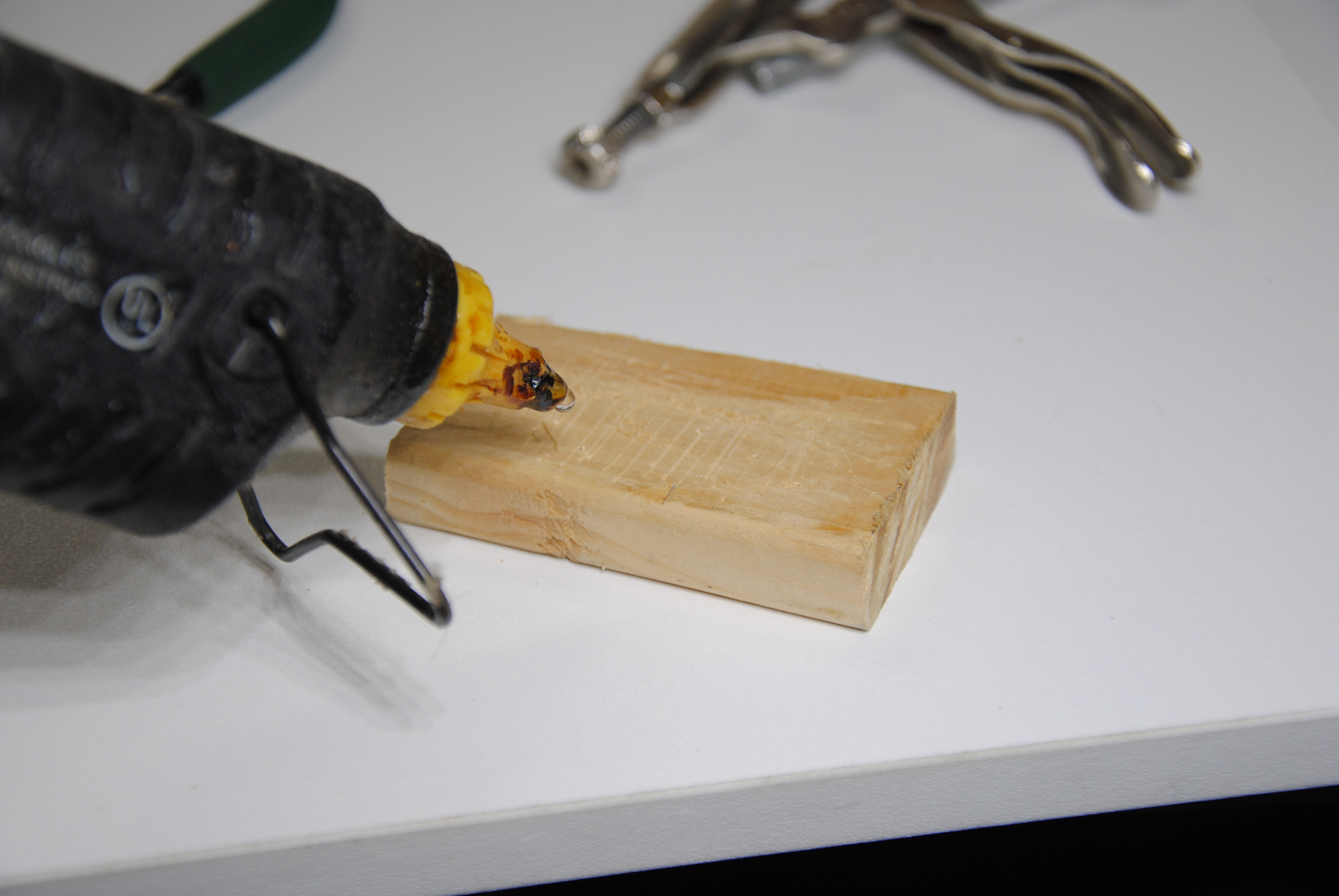 Picture of Glue the Wooden Pad Onto the Hammer