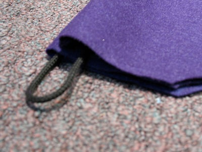 Fold Each Half Inside Out and Insert Nylon Cord in Top and Bottom Edges