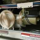 Replace the drain pump on a He3t washing machine (code F02)
