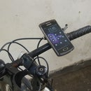 Mobile phone holder/mount for bike/bicyle-with ease earphone extension hack, camera hack and gps(bonus features!)
