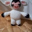 a doll dressed as a lamb (amigurumi)