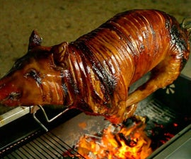 How to Roast a Whole Pig on a Spit (with Two Whole Chickens Inside!)