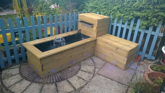 Raised Timber Pond With Waterfall and Bench