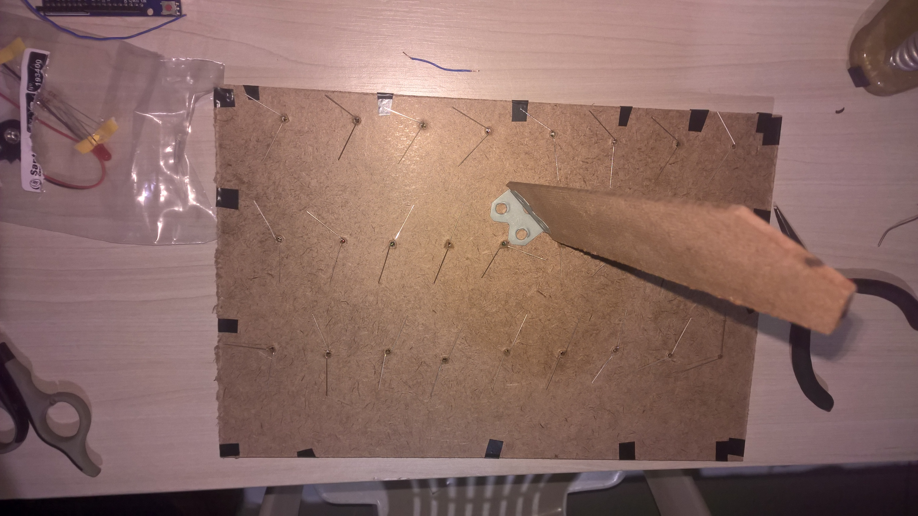 Picture of Drilling Holes and Placing the LEDs
