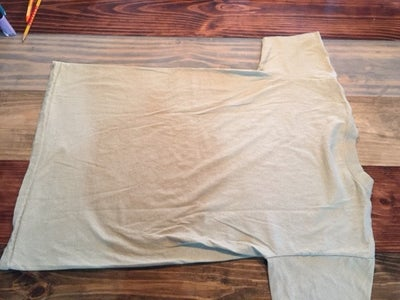 Lay Sand Tee Shirt Flat and Face Down.