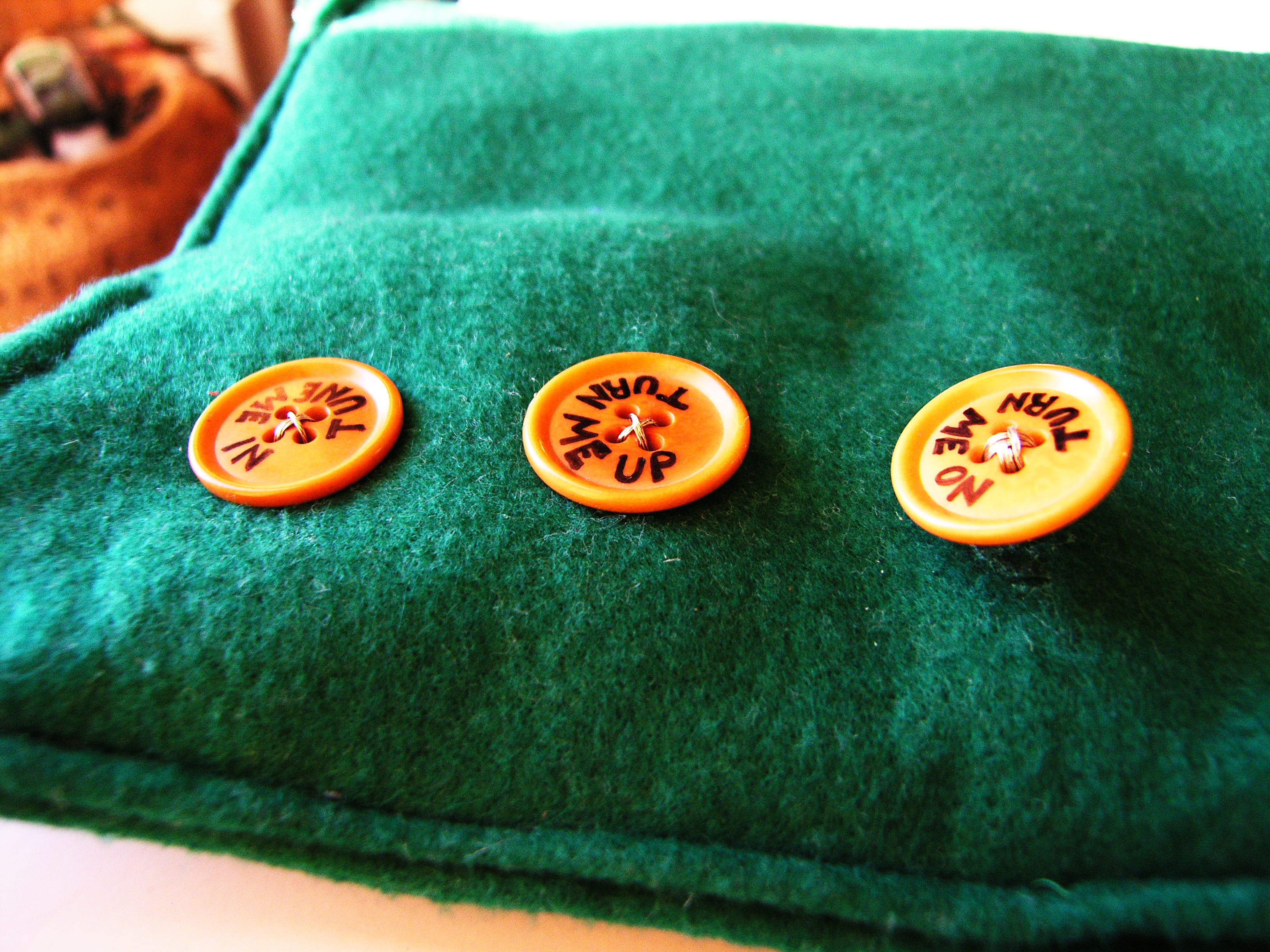 Picture of Cut Holes for Buttons and Glue/wire Them On