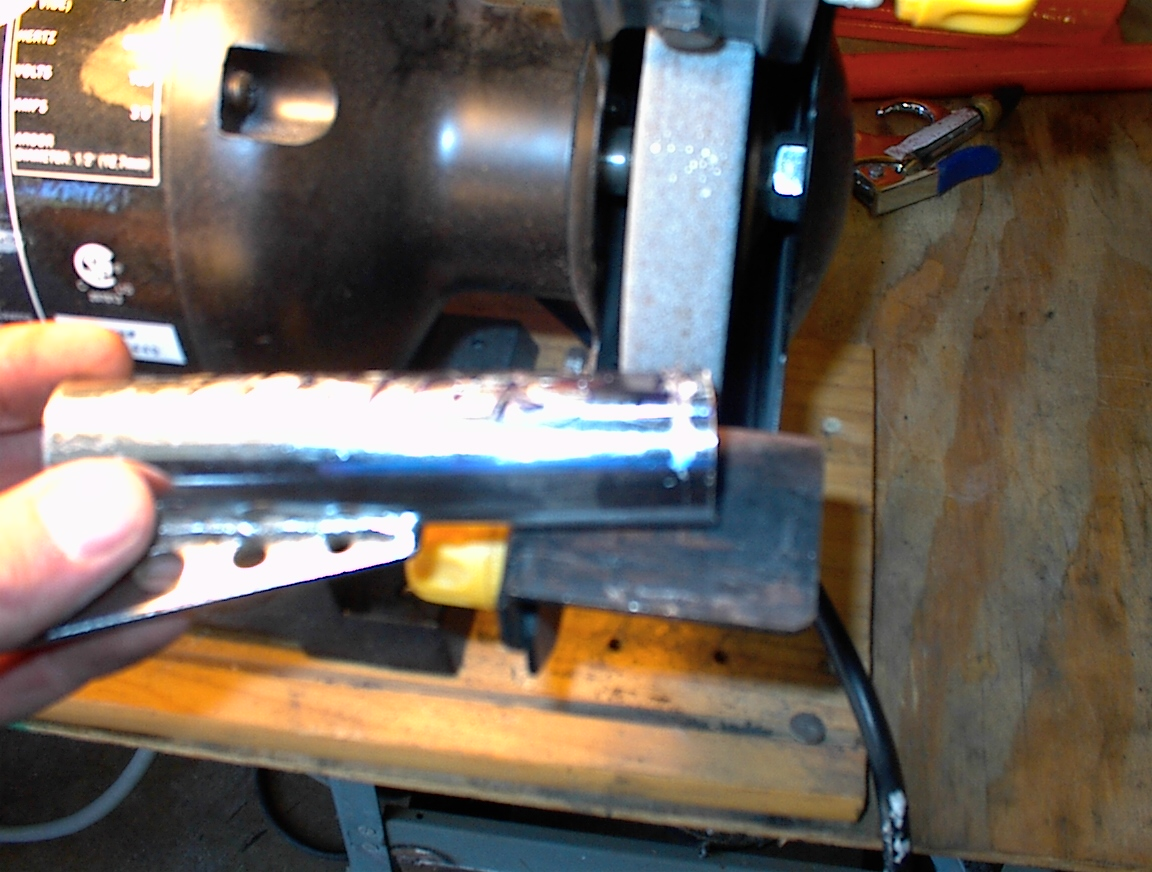 Picture of Forks Cut Apart and Grinding Them Down to Remove Paint for Welding