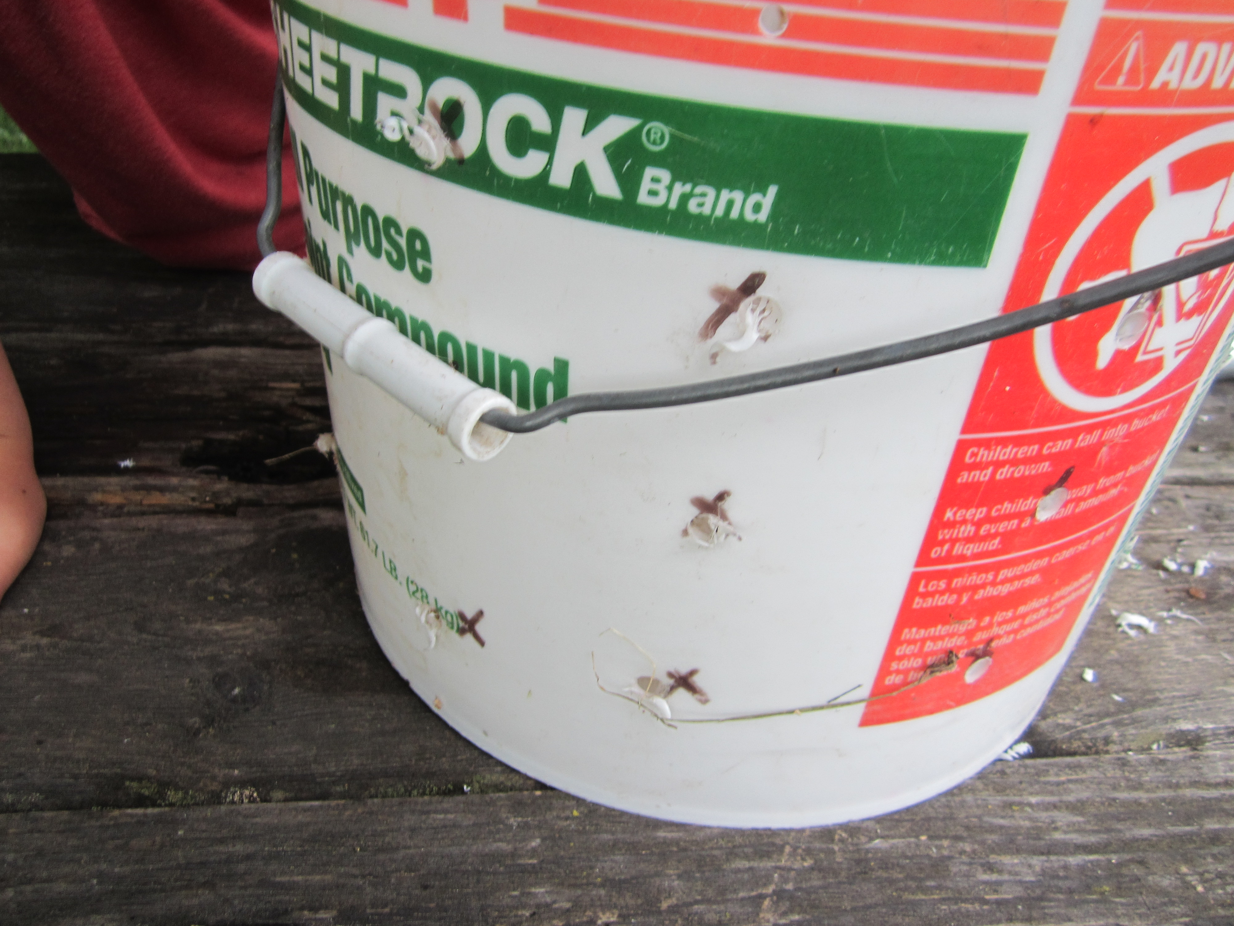 Picture of Drill Holes in Sheet Rock Bucket; Insert Nails