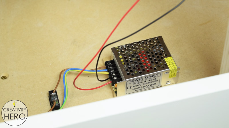 Picture of Inserting the Power Supply.