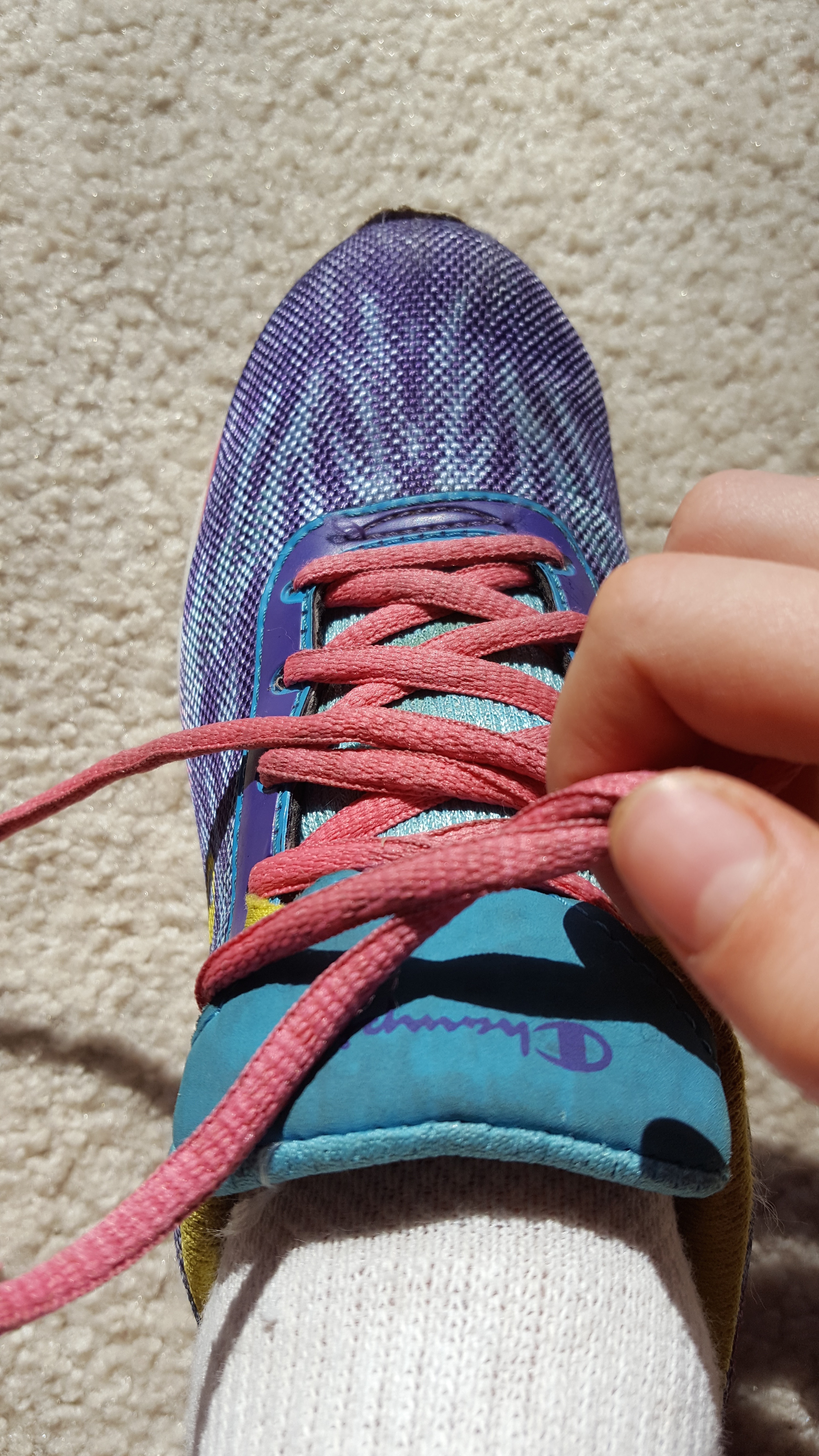 Picture of Pull Out on Both Laces to Tighten.