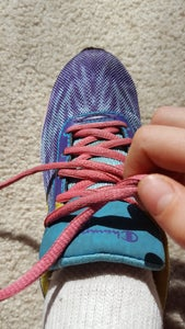 Pull Out on Both Laces to Tighten.