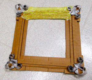 Picture of Using Mod Podge, Start Painting on Party Streamers to Frame.