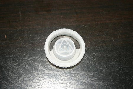 Make a Slot in the Cap to Fit the Colored Gels.