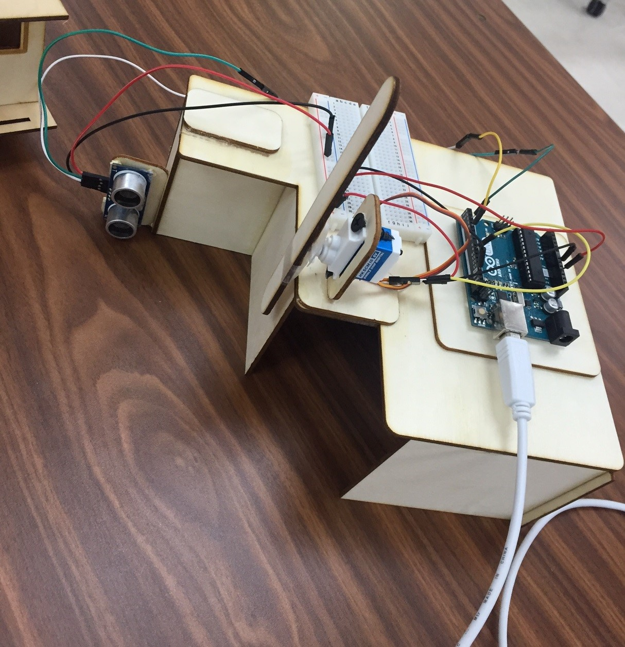 Picture of Controlling a Servo With Ultrasonic Sensor Signal Using Arduino ( Automated Gate System )