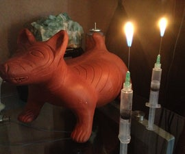 Syringe gas candle