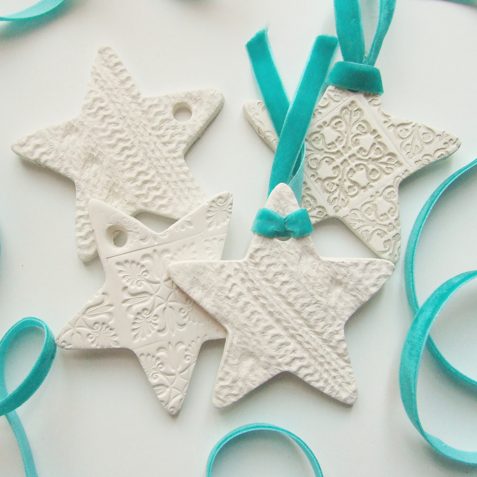 Picture of Embossed Clay Star Christmas Decorations.