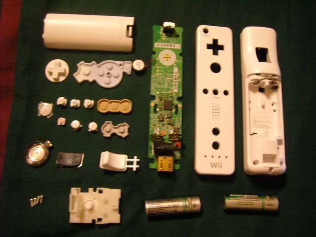 Picture of Dis-assembly of Holster, Game Boy, and Wiimote