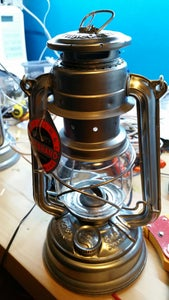 Buy an Old or New Storm Lantern or Hurricane Lantern or What Ever Its Called.