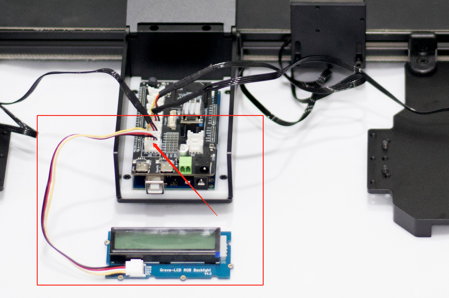 Picture of Connect LCD: Insert the LCD Cord Into the IIC of the Main Control Board
