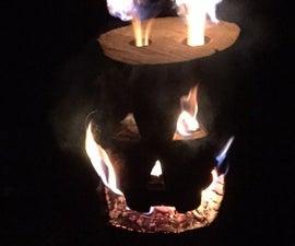 Log Rocket Stove Jack-O-Lantern