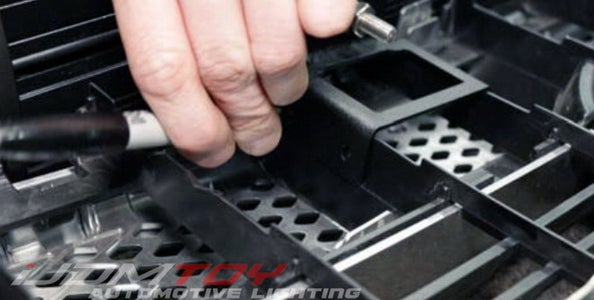 Mount Your LED Light Bar Base Bracket Onto the Columns of the Grille Behind.