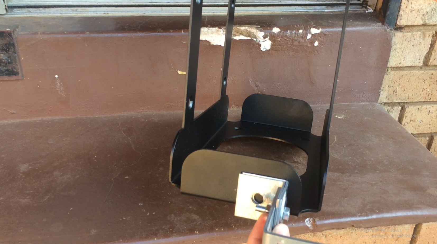 Picture of Attach the Bracket to the Front Runner Jerrycan Holder.