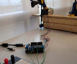 A solar tracking automatic motorized window blind retrofit using Arduino