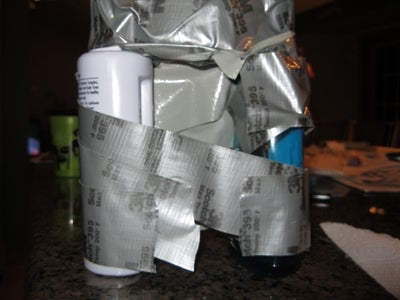 ''Duct Taping Three Containers Together''