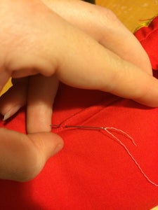Hand Sewing the Hole