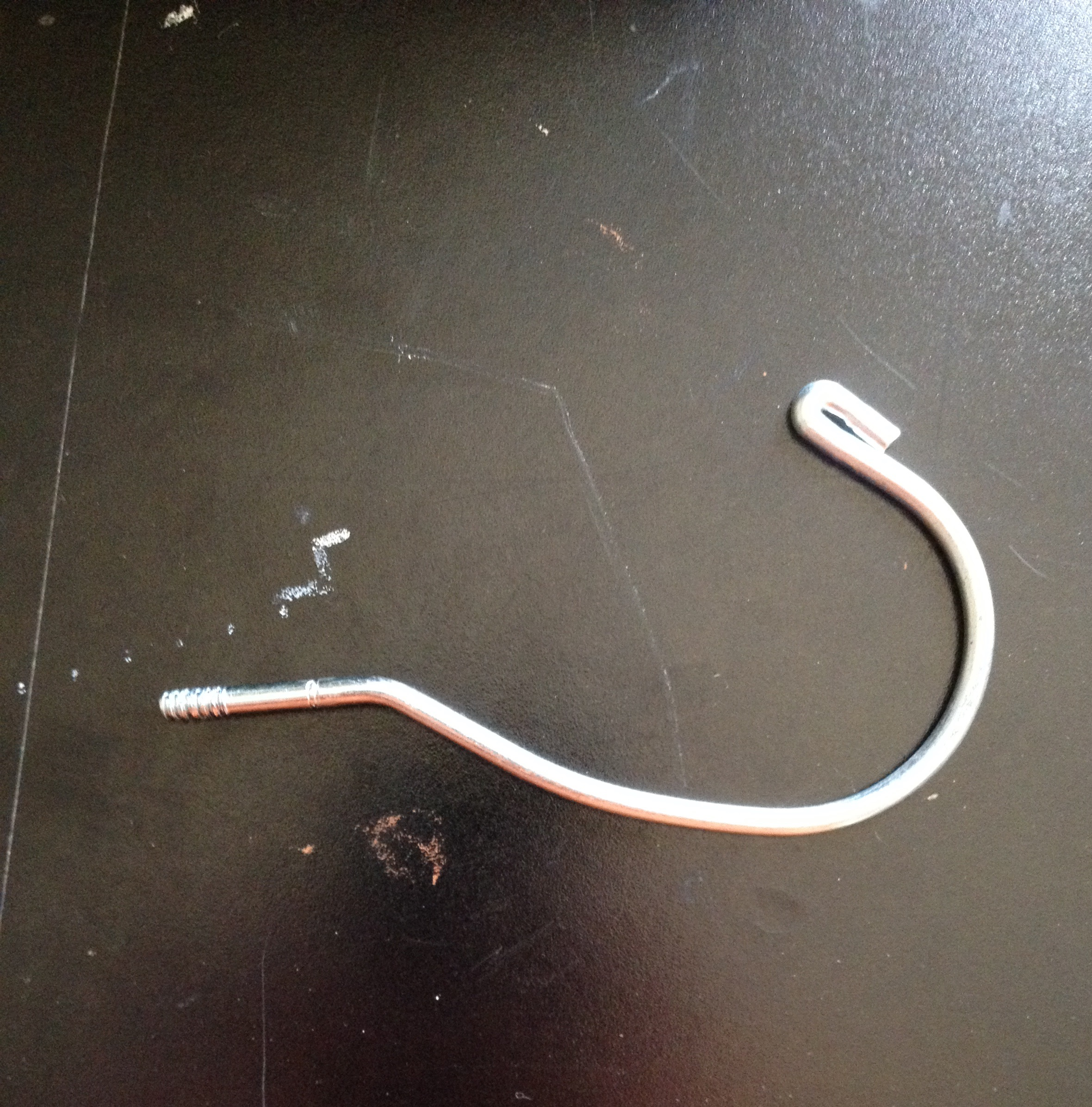 Picture of Removing the Hook From the Plastic Hanger.