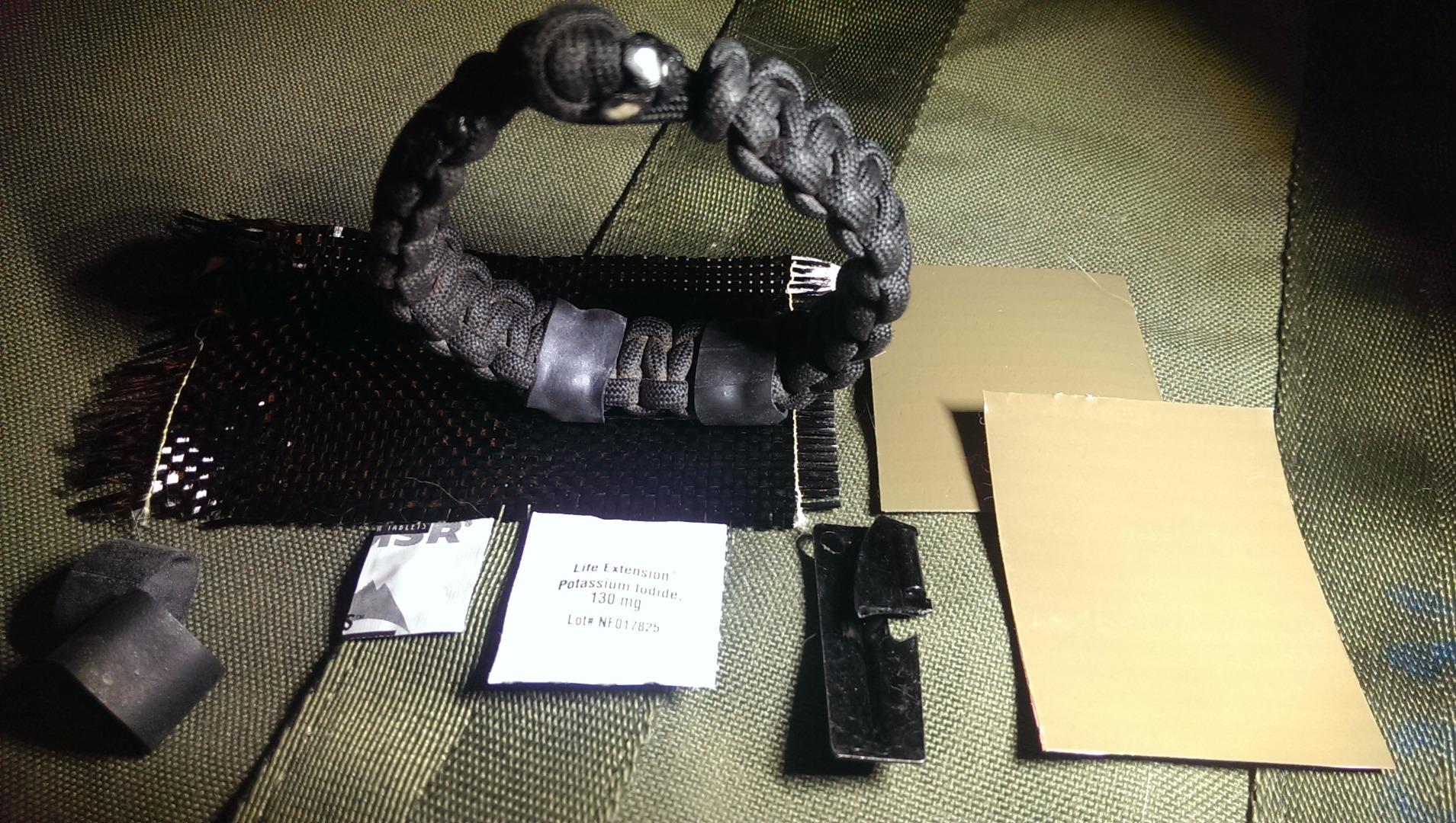 Picture of The Fallout Survivor: Nuclear and EMP Ready Paracord Bracelet- Anti-Radiation Tablet, Water Purification, Multi-Tool, Carbon Fiber Gas Mask