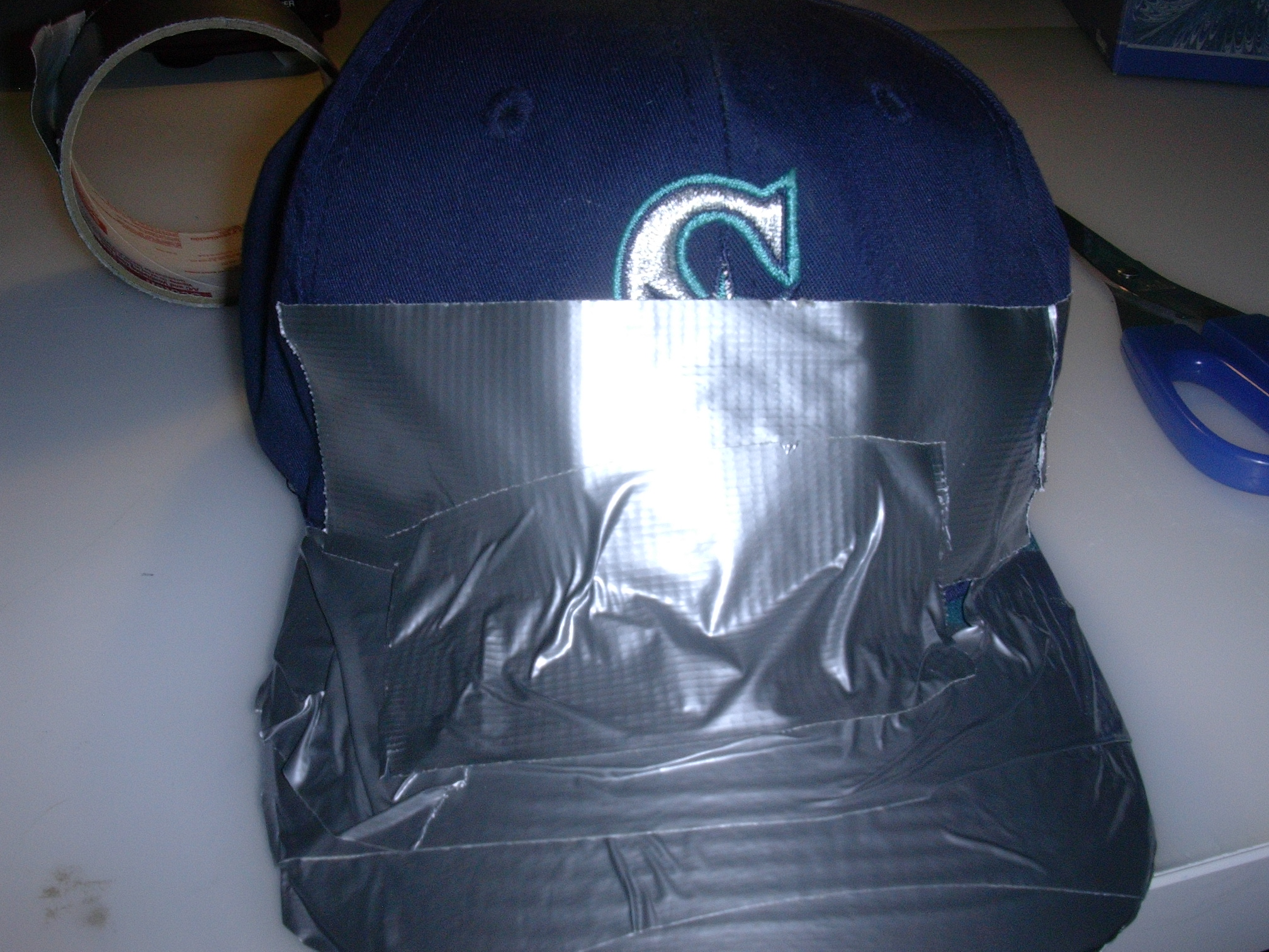 Picture of Wrap the Front and the Sides of the Hat in Duct Tape