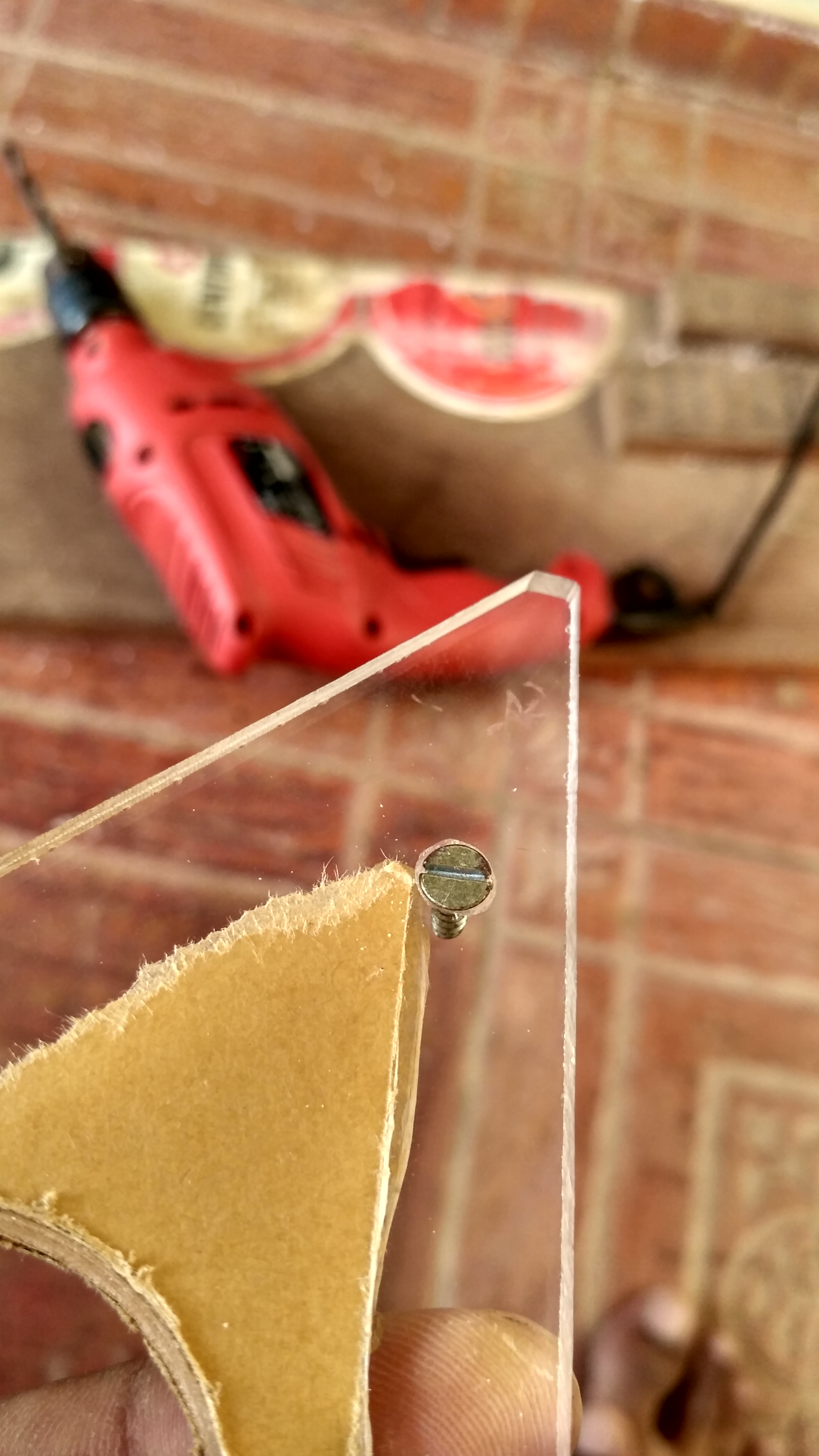 Picture of Making Holes on the Acrylic Sheet for the Screws:-