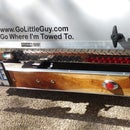 A Hitch Mounted Removable Wooden Bumper