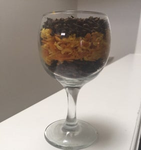 Add Into the Glass the Grated Orange Peel Until It Is Almost Three Quarter Full and Then Fill It Up With More Clove Seeds.