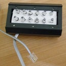 Phone line-powered flashlight