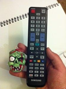 Mini ZOMBIFIED TV Remote Control Keychain!