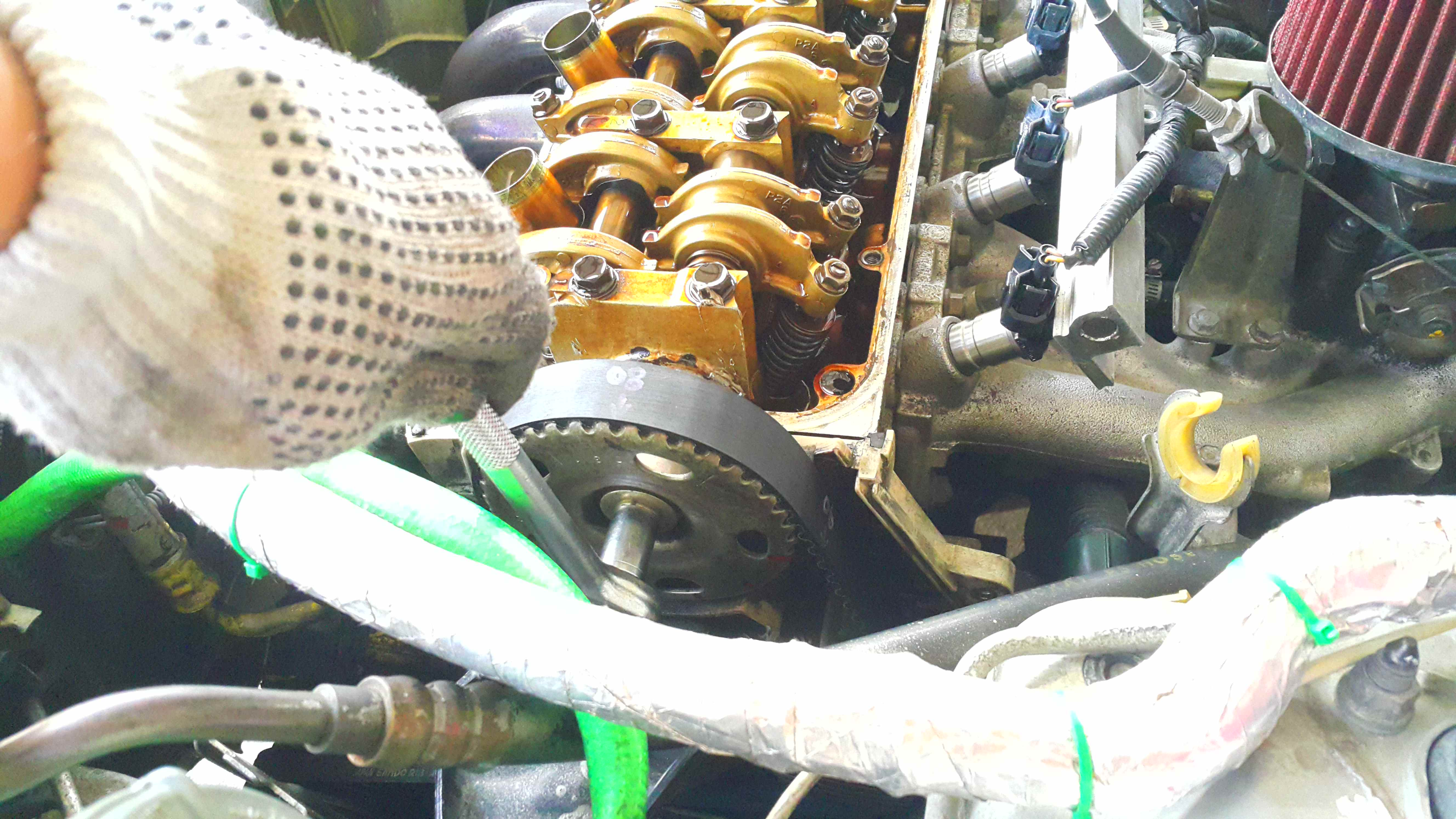 Picture of Removing the Timing Belt and Cam Gear Pulley.