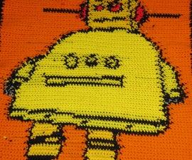 Robo Blanket: Crochet a blanket using a cross stitch pattern.