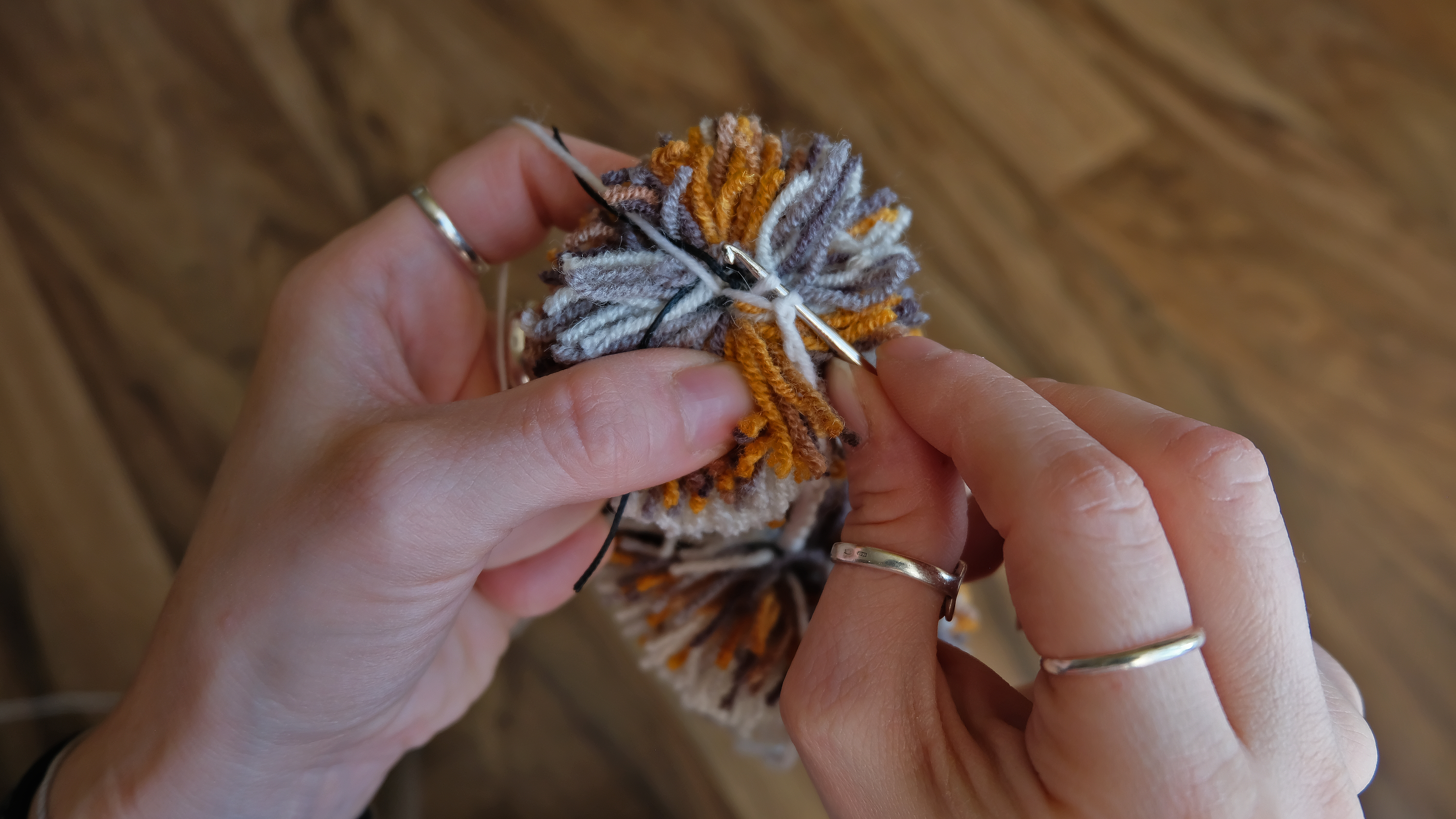 Picture of Crocheting. Connection With Next Pompom