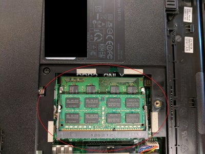 Take Out Panel Covering the RAM and Locate RAM