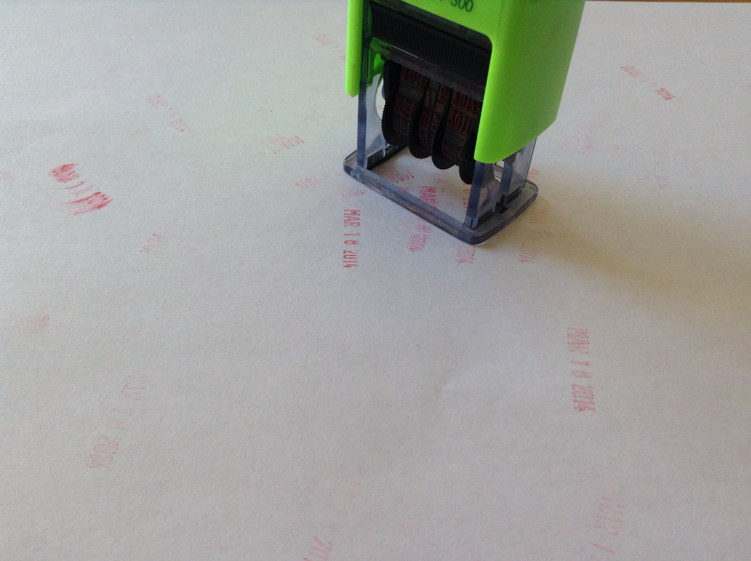 Picture of Stamp Multiple Times Until the Remaining Ink Runs Out.