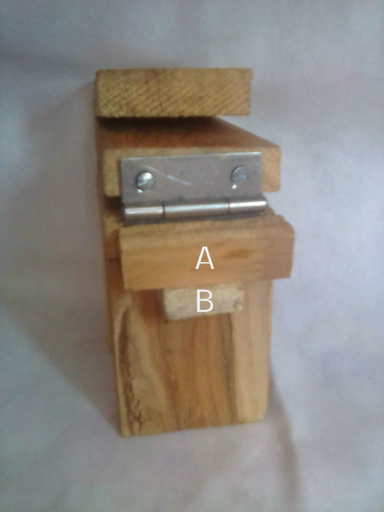Picture of PUT 'A' PIECE OF WOOD ON 'B' PIECE OF WOOD.NOW PULL PART-1 UPWARDS,THIS IS YOUR CHAIR.