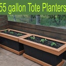 A 55 GALLON PLANTER