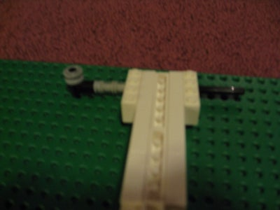 Put the Axle All the Way Into the First Assembly. (If You Are Using Two Axles Then Just Put One in Halfway)