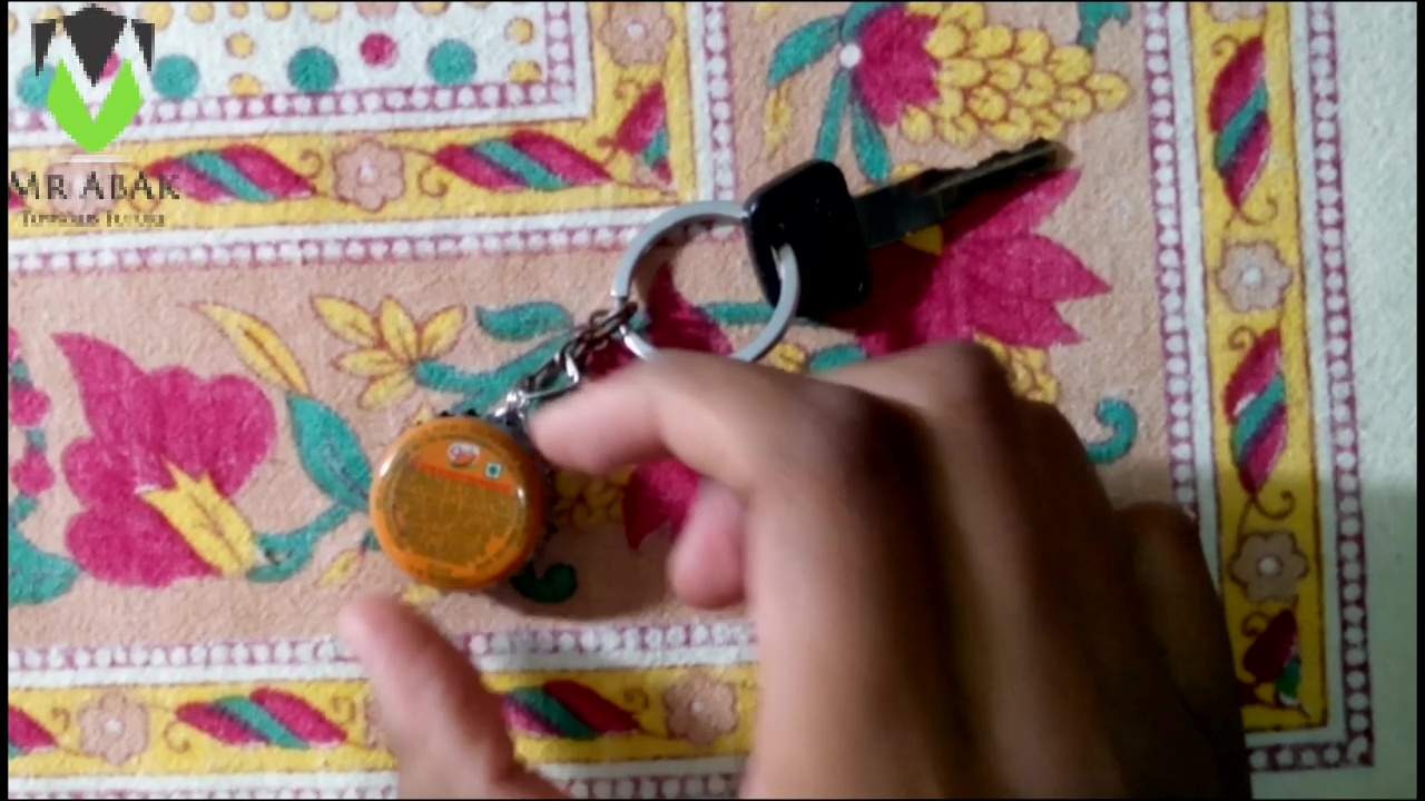 Picture of Bottle Caps Key-Ring : Attaching the Caps to the Key-chain