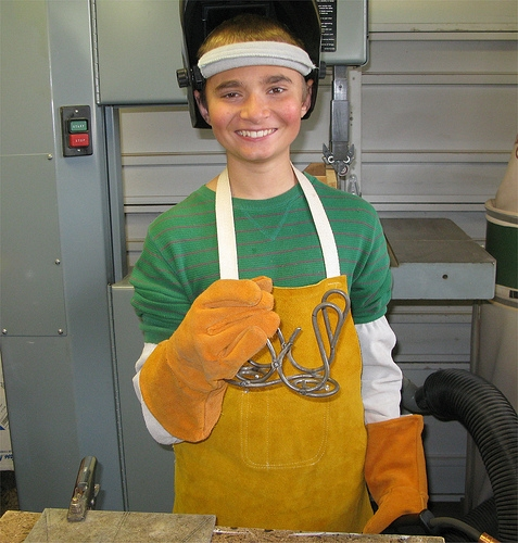 Picture of Brandon Welds a Napkin Holder