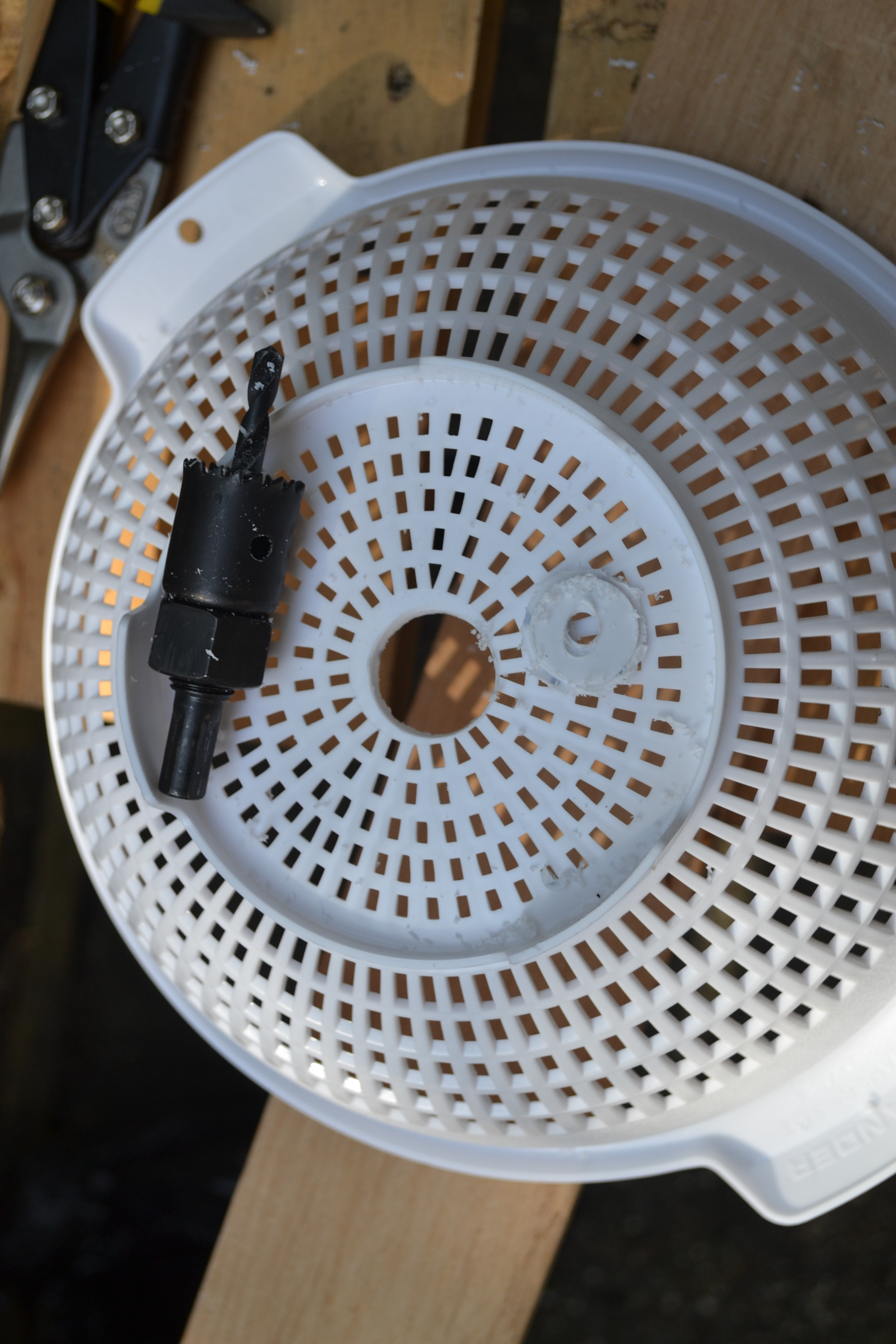 Picture of Put a 7/8 Inch Hole in the Bottom of the Plastic Colander.